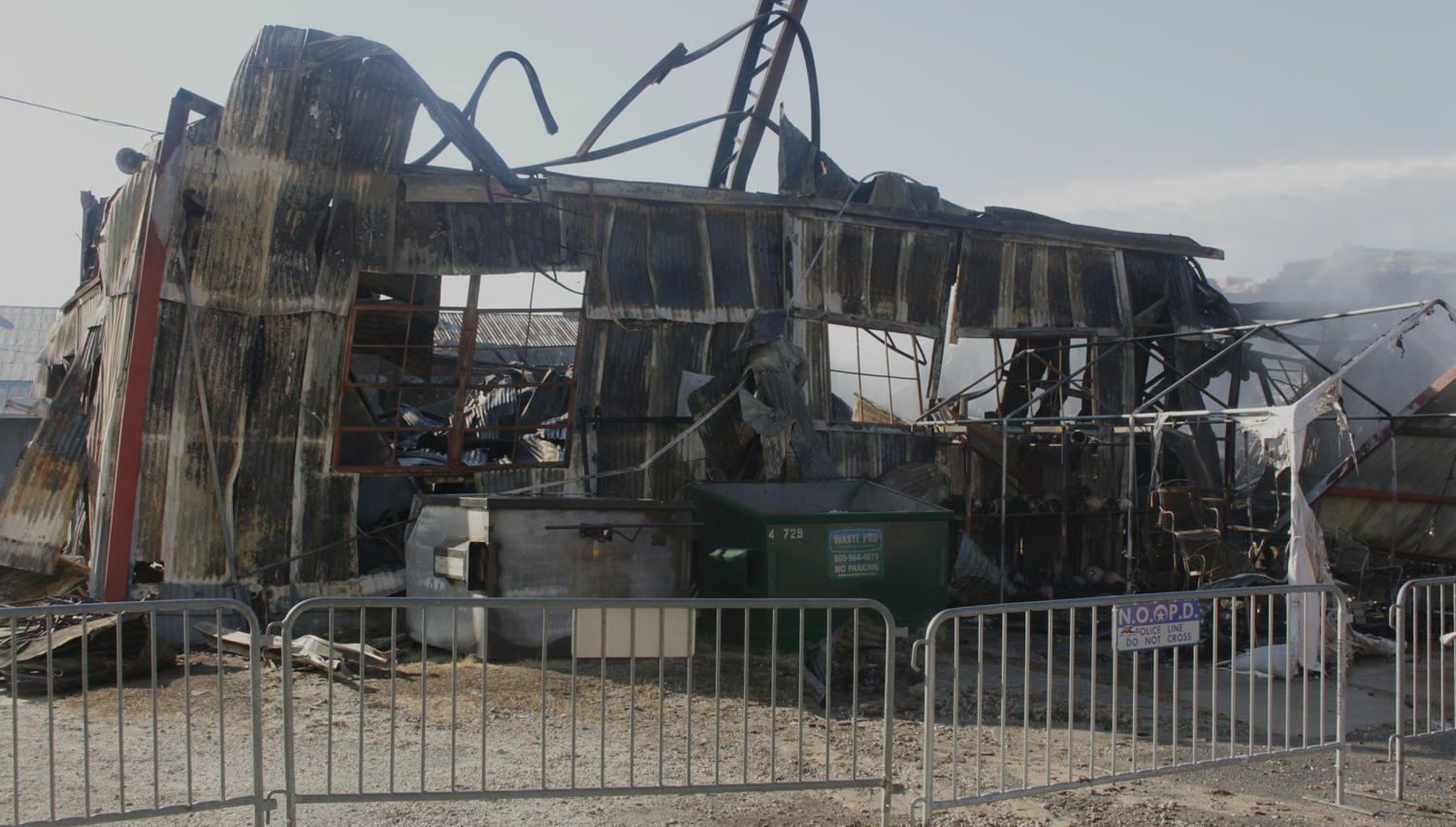 The warehouse holding Canal Furniture Liquidators and NOLA Til Ya Die, pictured here on April 24, stands damaged after being engulfed in flames Monday morning.  The cause of the fire has yet to be discovered and is under an ongoing investigation. Photo credit: Caleb Beck