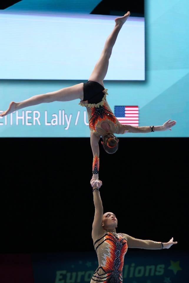 Political science freshman Sam Conway holding her partner Lally Seither in the air. Conway has chosen to leave active competition. Eric Chang/Courtesy.