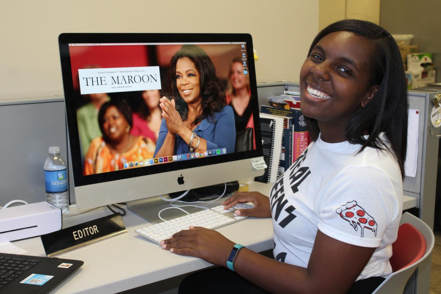 Sidney Holmes, mass communications senior, sitting at her Editor-in-Chief desk for the last time. Sidney gives us her own advice on how to keep motivated in school and in life, even citing Oprah Winfrey as a tip. Photo credit: Vanessa Alvarado
