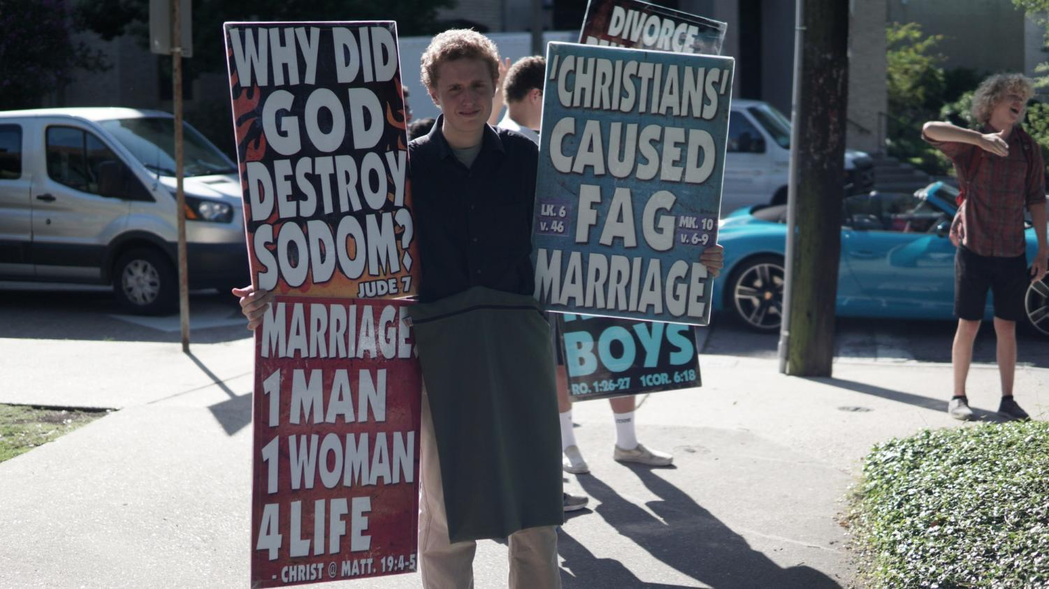 A+Westboro+Baptist+Church+member+displaying+his+signs+on+Loyola%27s+campus.+Photo+credit%3A+Jacob+Meyer