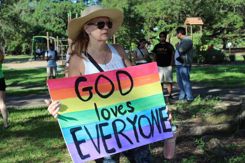 A+counter-protester+showing+her+sign+in+opposition+of+the+Westboro+Baptist+Church.+Photo+credit%3A+Rhon+Ridgeway