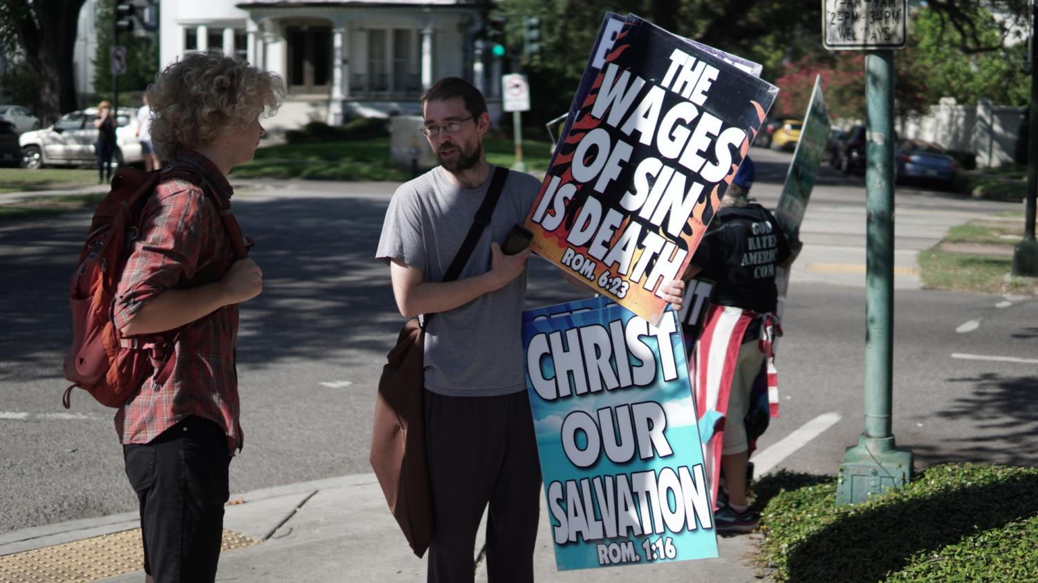 A Loyola student confronts a Westboro Baptist Church member on June 28, 2018. Photo credit: Jacob Meyer