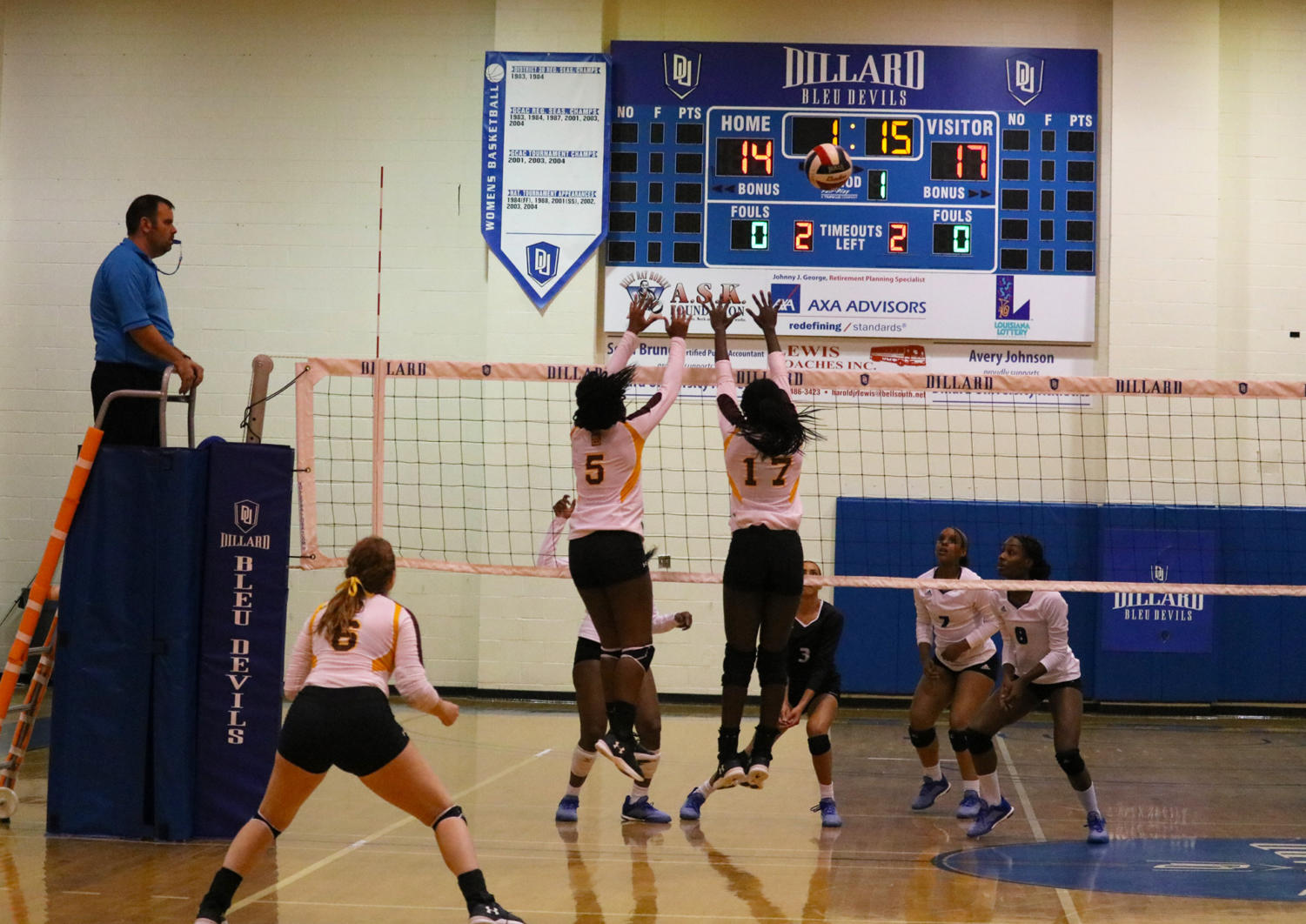 General studies freshman Jordan Bernard (5) and biology junior Champagne Cunningham (17) block the ball in the first set against Dillard University. Bernard tallied 17 total kills against Dillard University. Photo credit: Sidney Ovrom