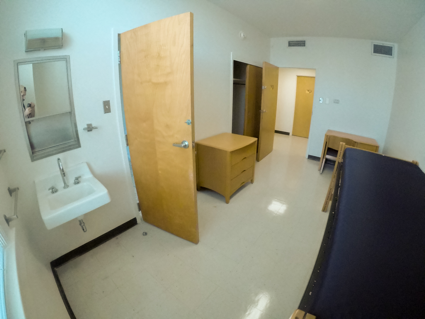 A+typical+bedroom+in+Founders+Hall+includes+a+bed%2C+vanity+sink%2C+dresser-drawers%2C+closet%2C+and+desk.++Rooms+such+as+this+are+small+in+size+but+only+need+to+accommodate+one+student+unlike+most+rooms+in+Loyola%27s+residence+halls.+Photo+credit%3A+Jacob+Meyer