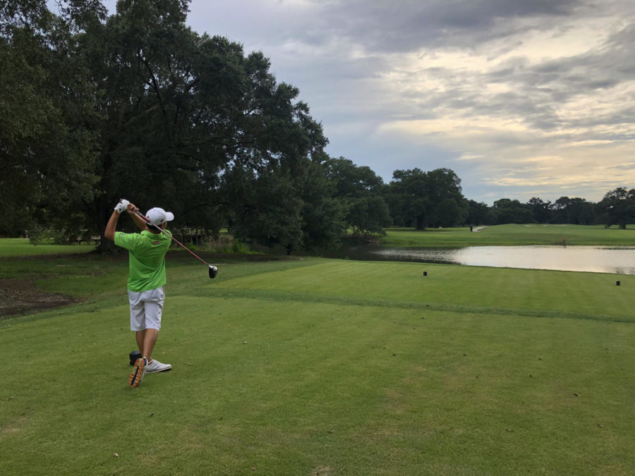Finance+freshman+Chong+Li+Lee+tees+off+at+Bayou+Oaks+City+Park.+Li+is+from+Johor%2C+Malaysia%2C+but+chose+Loyola++and+joined+the+golf+team.+Photo+credit%3A+Drew+Goff
