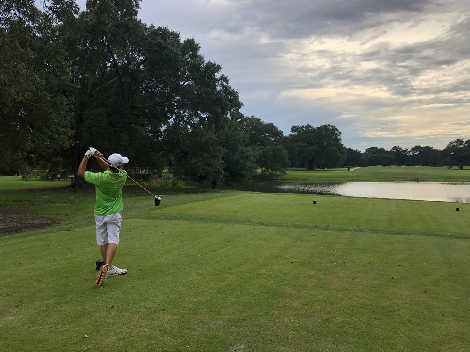 Finance freshman Chong Li Lee tees off at Bayou Oaks City Park. Li is from Johor, Malaysia, but chose Loyola  and joined the golf team. Photo credit: Drew Goff