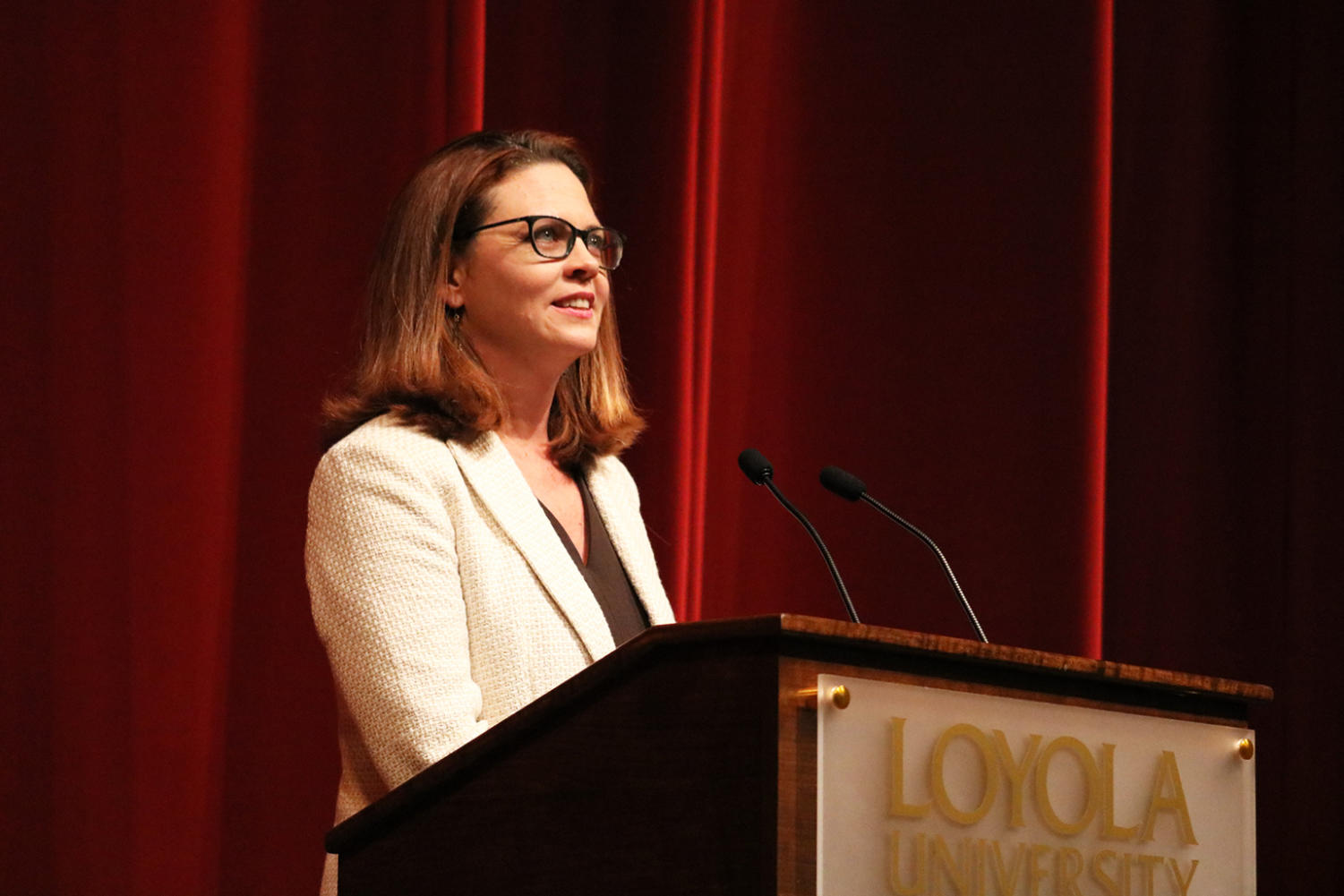 President Tania Tetlow speaks to the faculty of Loyola at the President's Convocation Fall 2018 on Monday, August 13 in Roussell Hall. Tetlow said she looks forward to being involved with the lives of Loyola students, faculty and staff while living out Loyola's Jesuit values. Photo credit: Sidney Ovrom