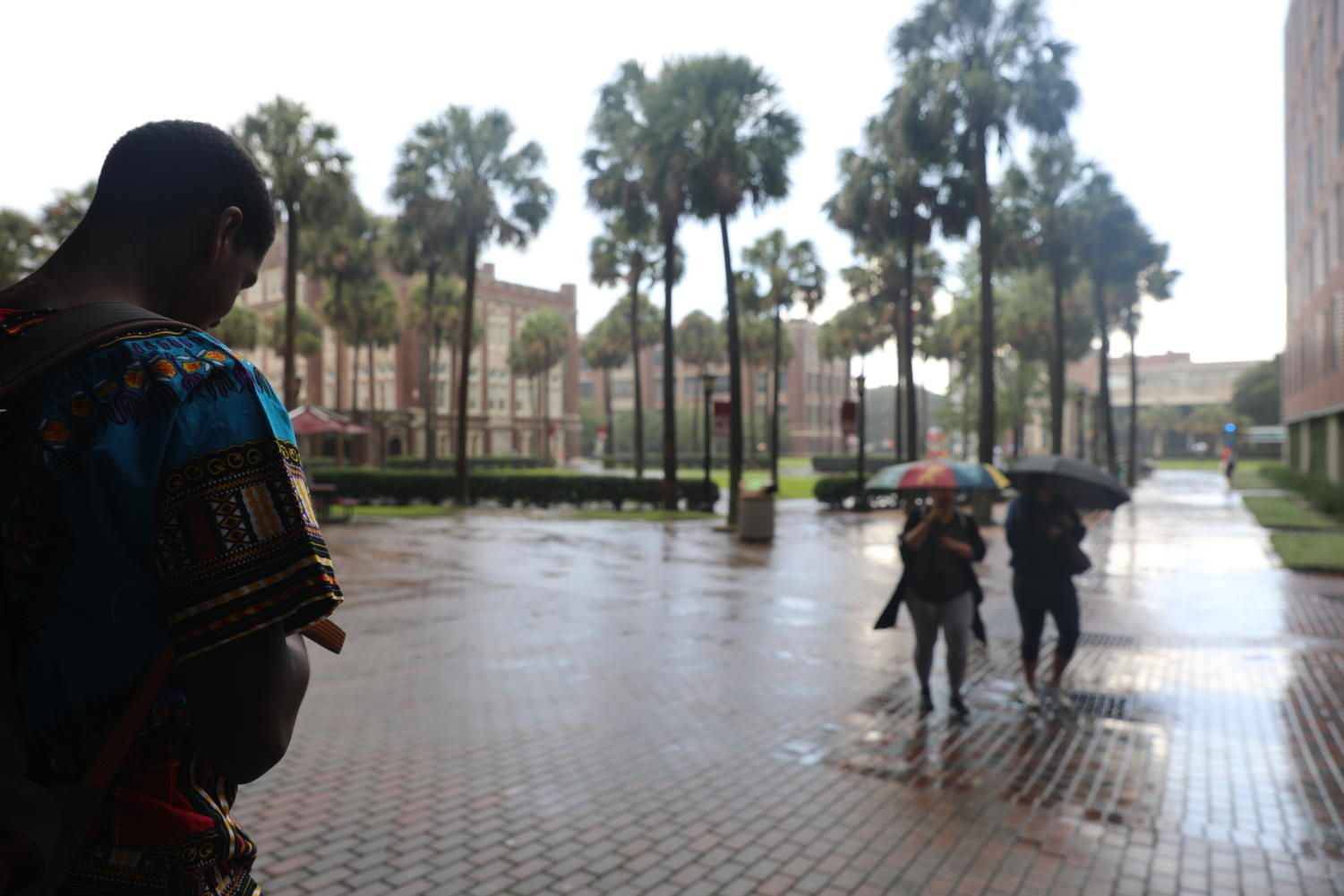 Loyola students try to avoid a sudden rain shower on Aug. 30, 2018. Loyola is currently changing its policy for hurricane preparedness to require campus evacuations during Category Two hurricanes.