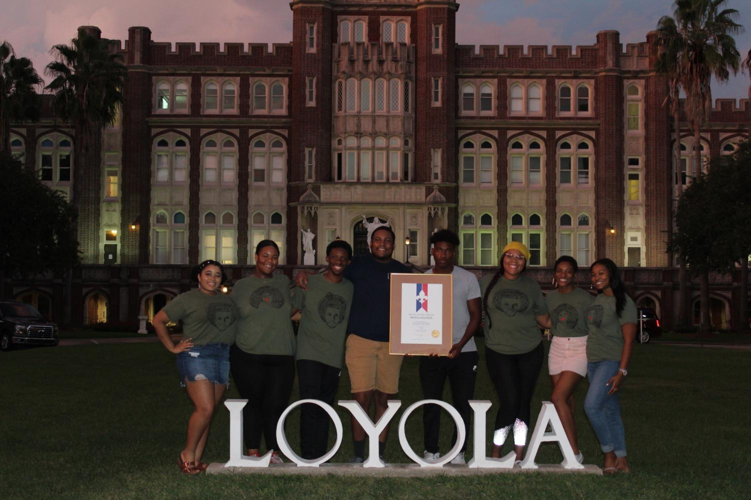Executive members of Black Student Union join together in front of Loyola to celebrate the organization's 50th anniversary. Black Student Union Executive Board: (left to right) Brealauna Leassear, Logan Jackson, Roshae Gibson, David Collins, Miles Clark, Brionna Adams, Jenkins Brady, and Sterling Holmes. Photo credit: Erin Haynes