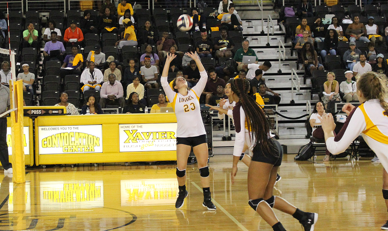 Education senior Maddie Huekels sets up for a possible kill. Huekels was named Southern States Athletic Conference Setter of the Week. Photo credit: Loyola New Orleans Athletics