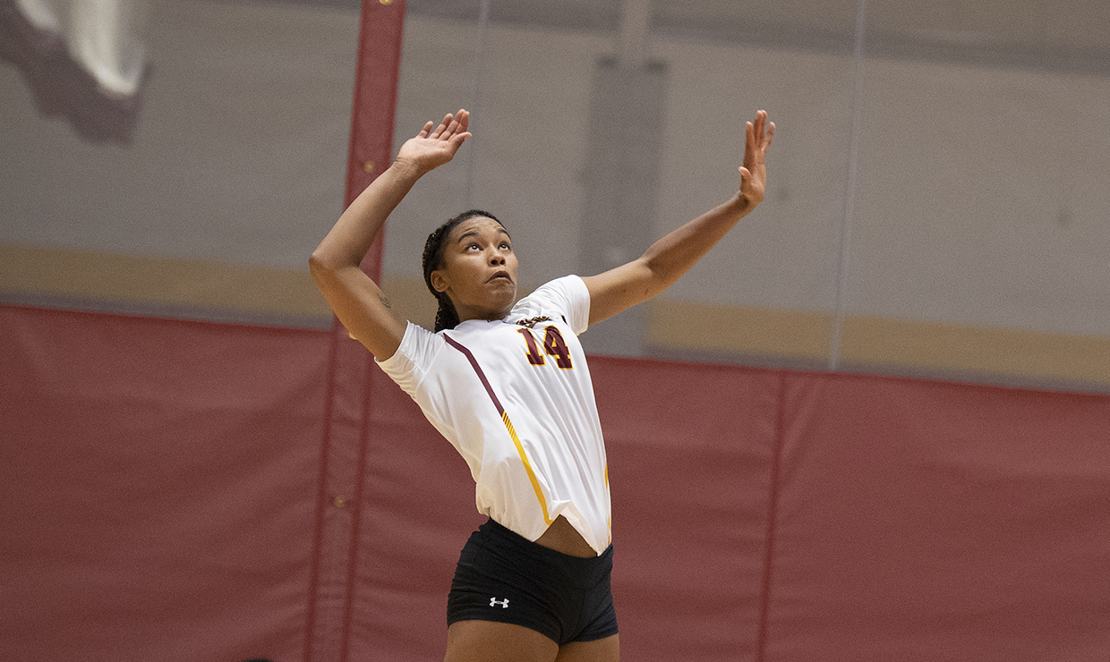 Mass communication senior Tylar Beckham eyes the ball. Beckham finished with 11 kills and five blocks against University of Mobile. Photo credit: Loyola New Orleans Athletics