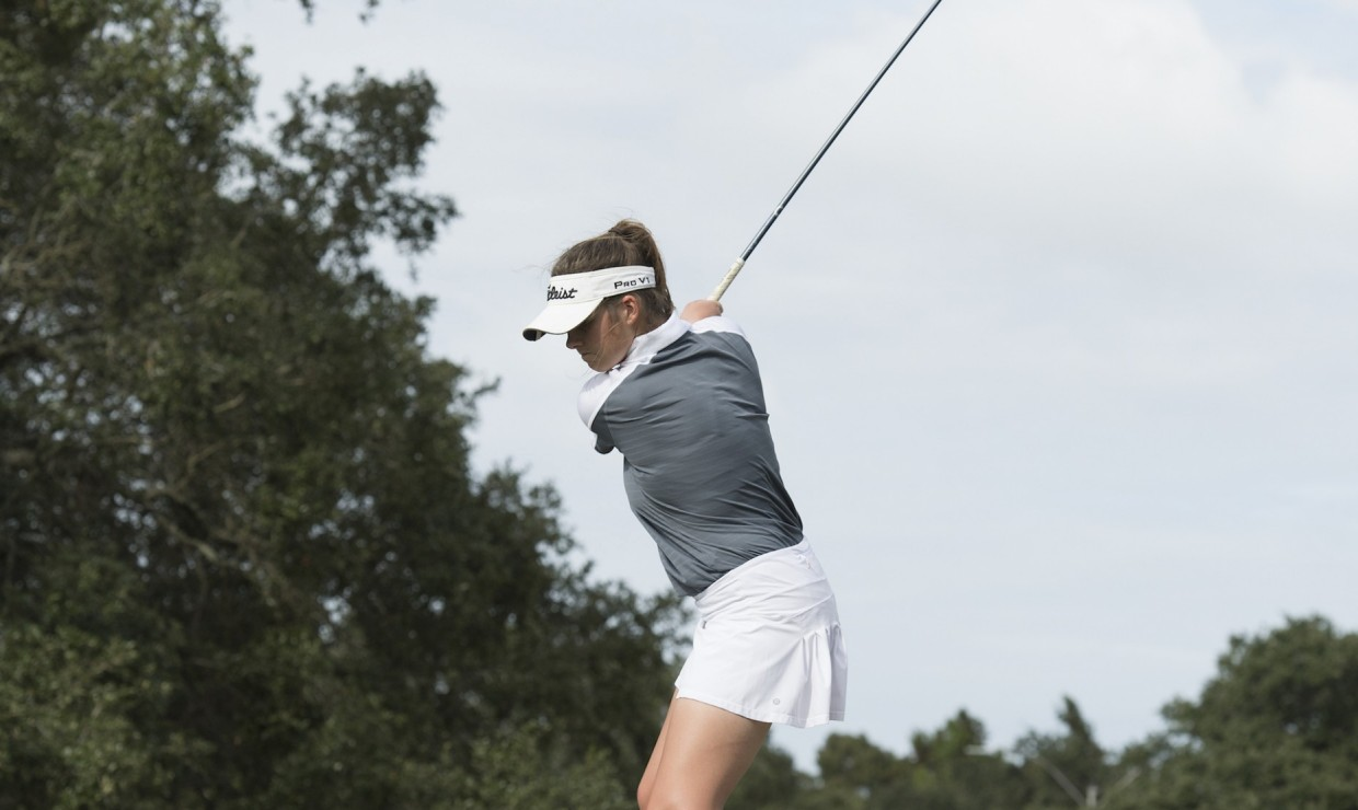One of the Loyola golfer's finishes her backswing. Business senior Daria Delfino led the way for the Wolf Pack finishing in fourth in the tournament. Photo credit: Loyola New Orleans Athletics