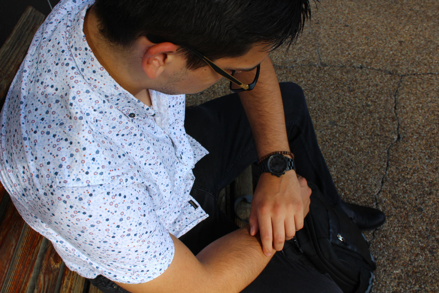 Cameron Kelley, business analytics junior, looks at his watch in the afternoon after class. Kelley is upset that his major requires two accounting classes. VANESSA ALVARADO/The Maroon. Photo credit: Vanessa Alvarado
