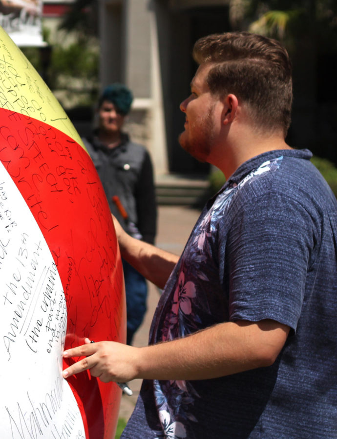 Loyola students exercise free speech through giant graffitied beach ball