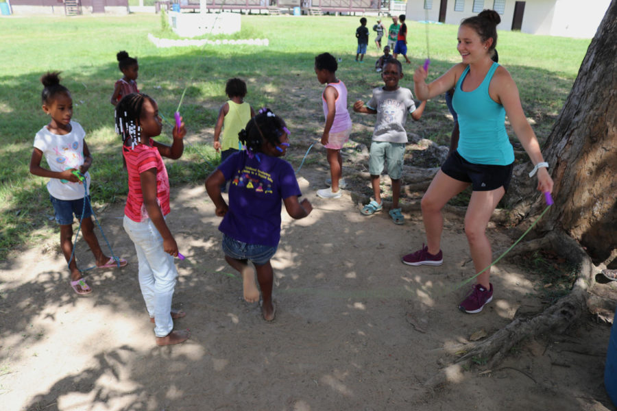 Public+relations+junior+Paige+Carter+twirls+the+jump+rope+around+for+the+children+in+Belize.+Carter+was+one+of+12+Loyola+athletes+who+went+on+the+trip.+Photo+credit%3A+Rev.+Ted+Dziak+S.J.