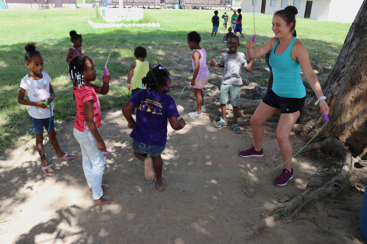 Public relations junior Paige Carter twirls the jump rope around for the children in Belize. Carter was one of 12 Loyola athletes who went on the trip. Photo credit: Rev. Ted Dziak S.J.