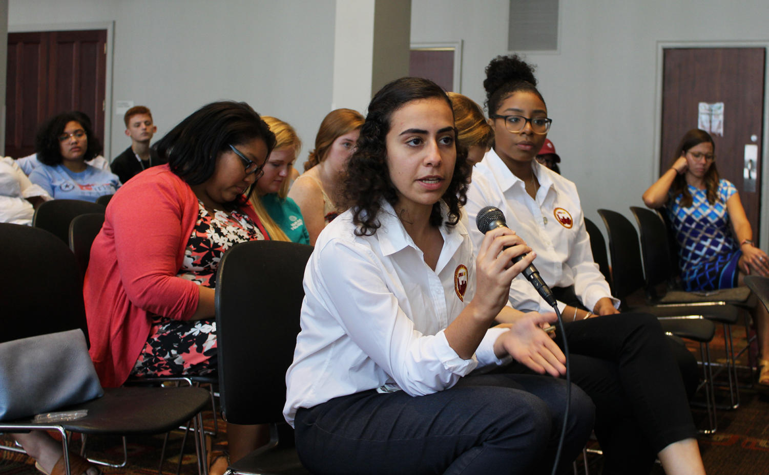 Rana Thabata, political science junior and SGA chief justice, asks the panel to clarify the student confusion about work study. Many students attended the town hall on Tuesday, Sept. 18, to voice their concerns about the student experience. Photo credit: Anderson Leal
