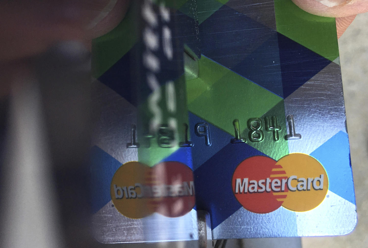 FILE - In this June 15, 2017, file photo, a customer inserts a Mastercard credit card to pay for parking in Haverhill, Mass. Mastercard rolled out a digital trade platform Wednesday, Sept. 12, 2018, designed to make it easier for companies to do business around the world. (AP Photo/Elise Amendola, File)