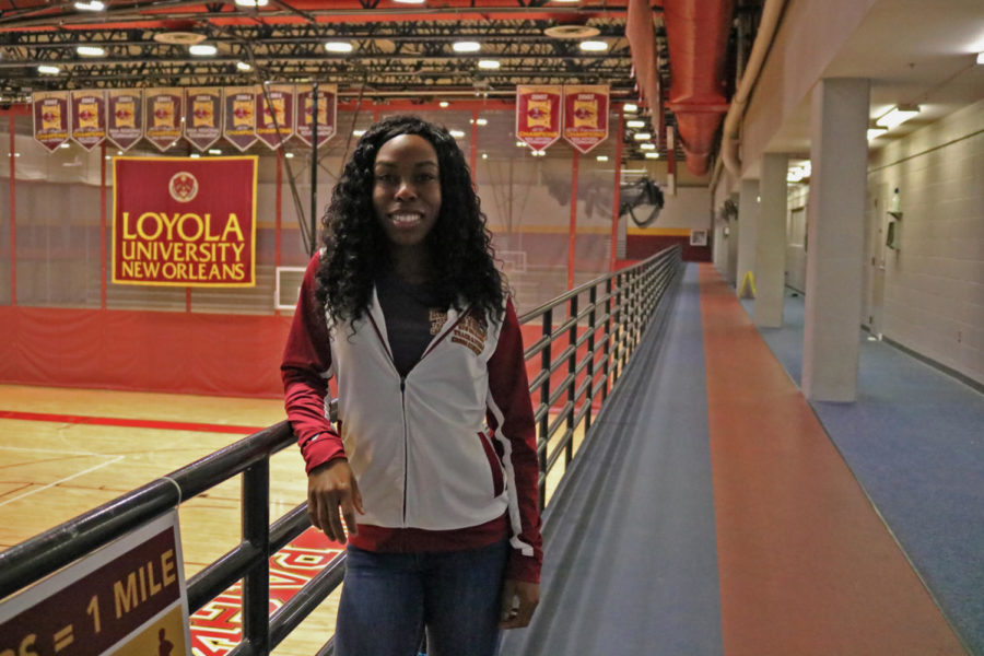 Amani+Bryant+poses+in+the+University+Sports+Complex.+Bryant+was+hired+Sept.+24+as+an+assisstant+coach+for+both+the+cross+country+and+the+track+and+field+programs.+Photo+credit%3A+Sidney+Ovrom