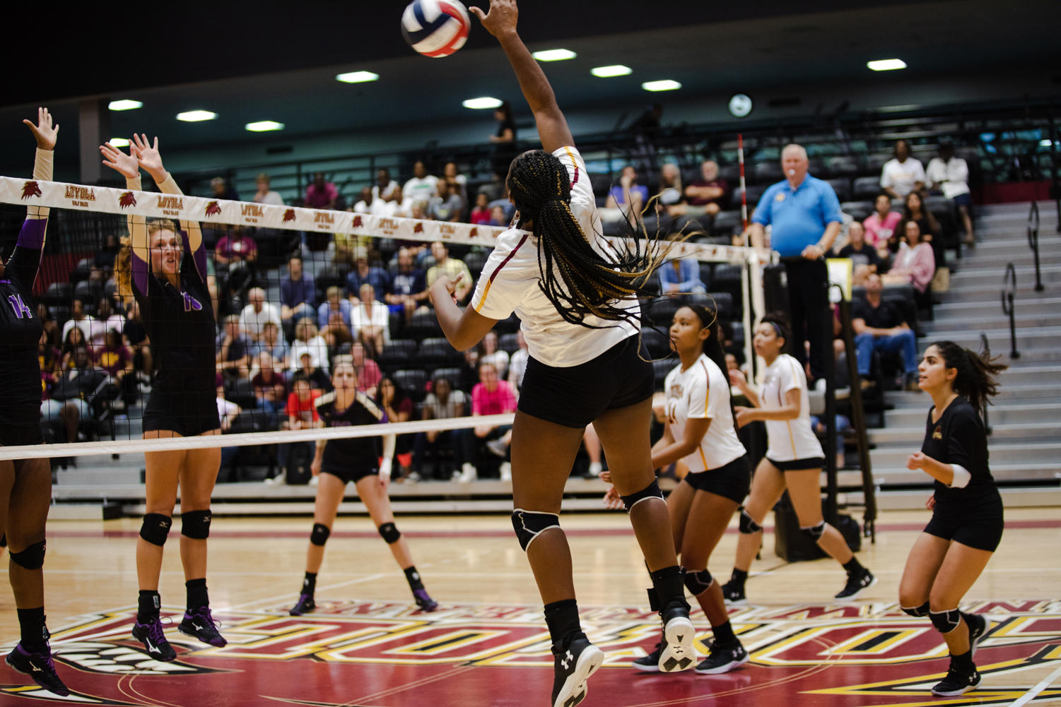 General studies freshman Jordan Bernard goes for a kill in the home opener against Bethel University. Bernard led the team in kills against Faulkner University with 13 kills. Photo credit: Julia Santos