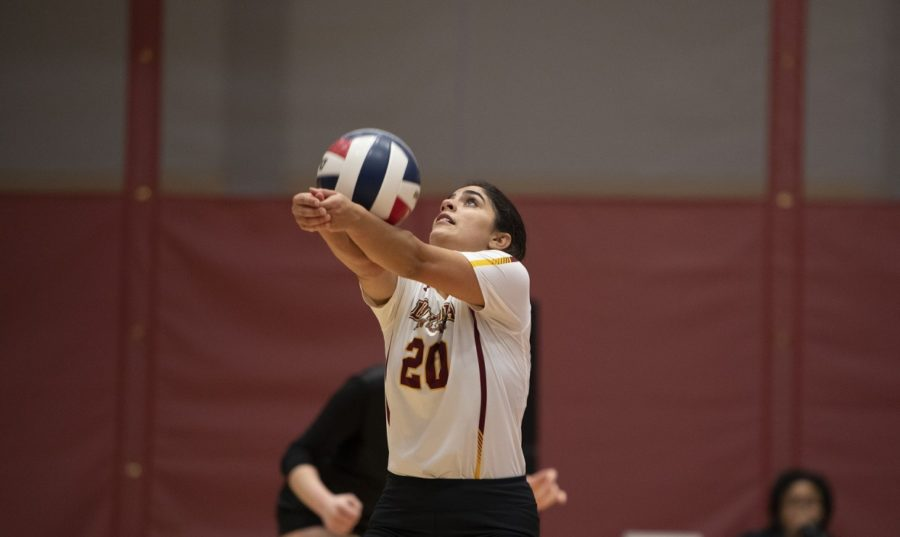 Psychology+pre-med+sophomore+Helene+Masone+bumps+the+ball.+Masone+finished+with+nine+digs+in+the+final+game+against+Faulkner.+Photo+credit%3A+Loyola+New+Orleans+Athletics