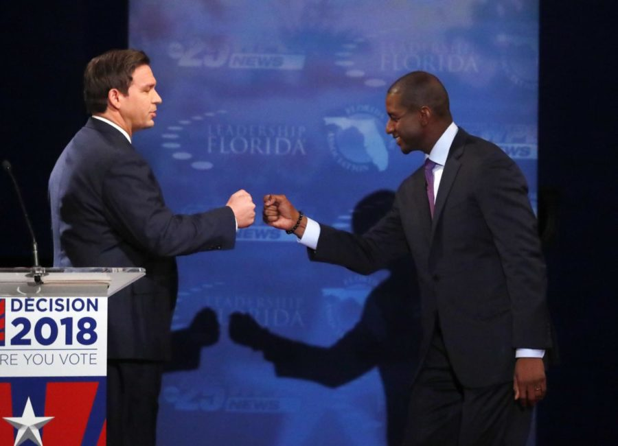 IN+this+Oct.+24%2C+2018%2C+photo%2C+Florida+gubernatorial+candidates%2C+Republican+Ron+DeSantis%2C+left%2C+and+Democrat+Andrew+Gillum+fist+bump+after+a+debate+at+Broward+College+in+Davie%2C+Fla.+The+final+stretch+of+the+midterm+campaign+is+increasingly+dominated+by+debate+over+one+of+the+most+sensitive+issues+in+American+political+culture%3A+Race.+In+Florida%2C+accusations+of+racism+are+playing+a+central+role+in+the+hotly-contested+campaign+for+governor.+DeSantis+chafed+at+questions+about+his+ties+to+supporters+who+have+made+inflammatory+comments.+%28AP+Photo%2FWilfredo+Lee%2C+Pool%29
