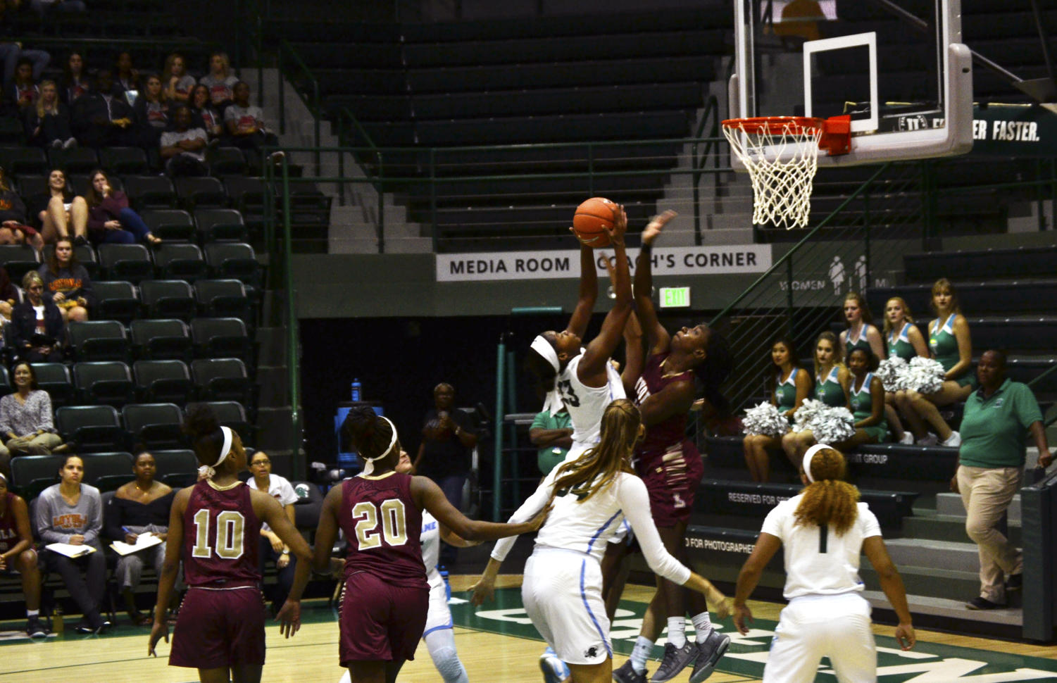 Loyola goes for a block. The Wolf Pack finished with eight blocks in the game. Photo credit: Andrew Lang