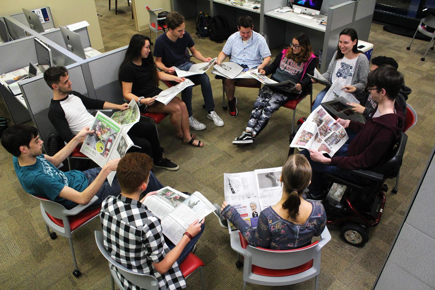 Part of The Maroon editorial board sits and discusses the latest issue of the newspaper. Photo credit: Andres Fuentes