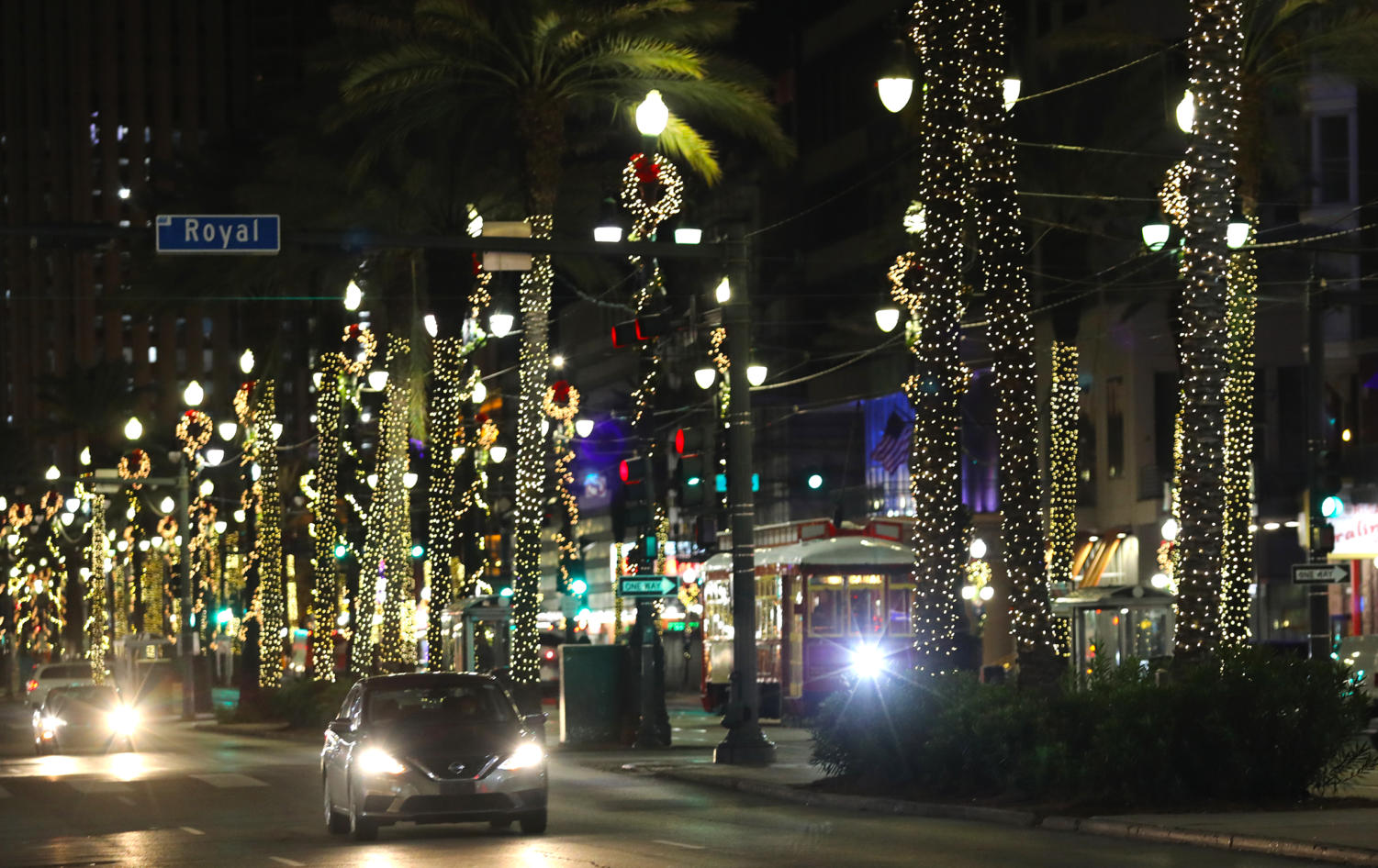 The downtown stretch of Canal St. is fitted for the holidays as lights wrap around trees and lamp posts. Photo credit: Andres Fuentes