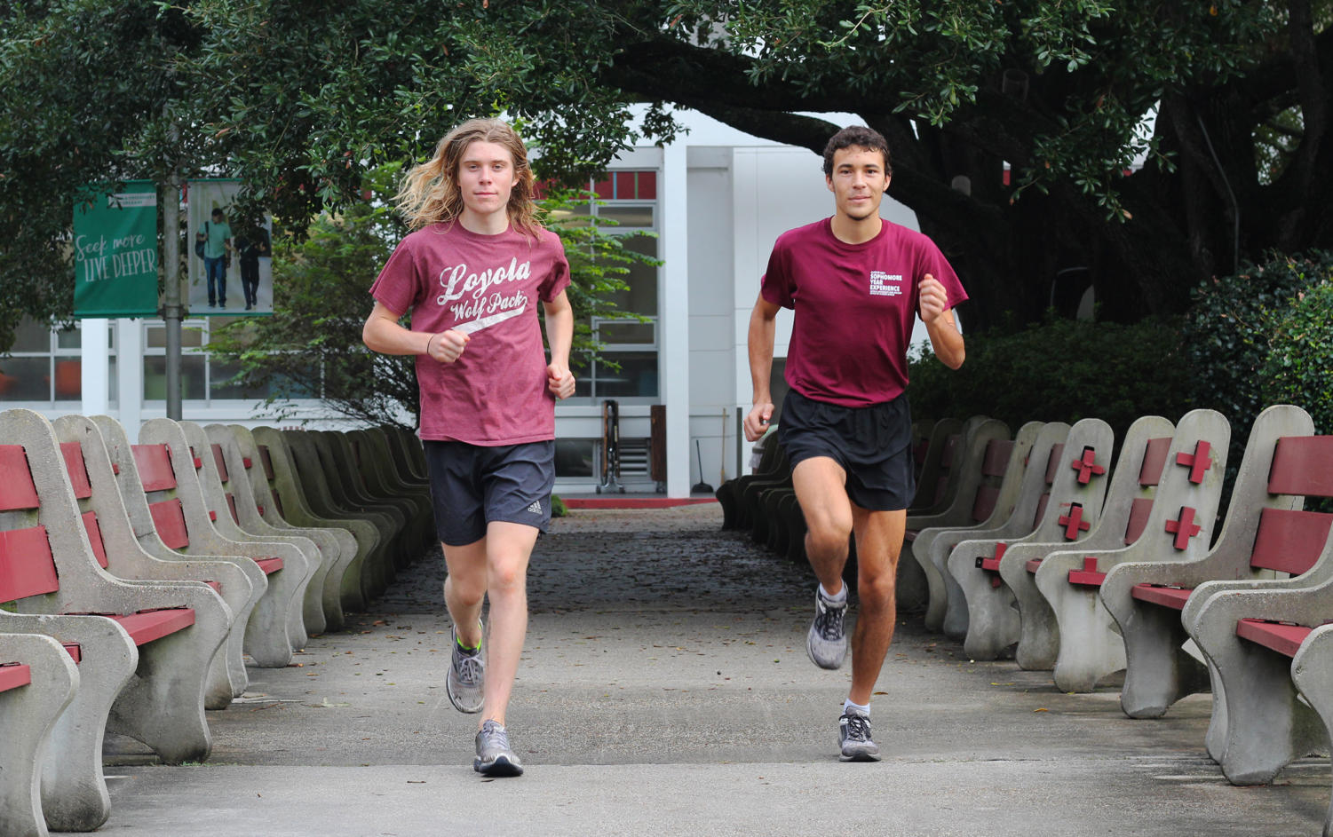 Environmental studies sophomore Walter Ramsey  (left) and pyschology sophomore Hayden Ricca (right) run in the peace quad. Ricca and Ramsey both qualified for the National Association for Intercollegiate Athletics Cross Country National Championships. Photo credit: Cristian Orellana