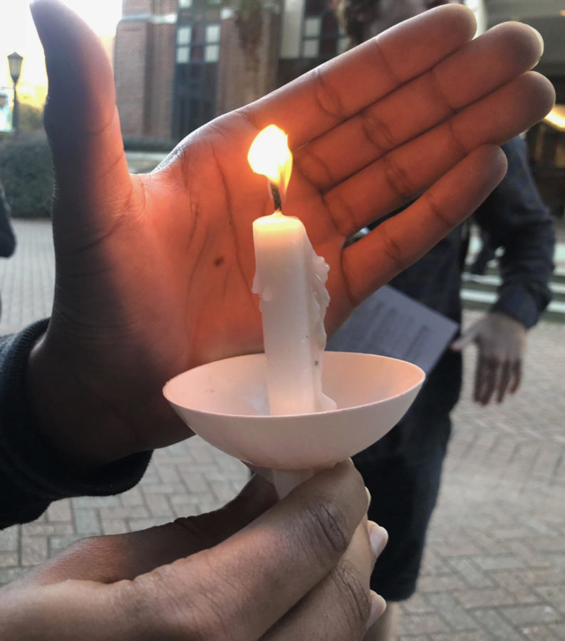 Community+members+gather+outside+the+St.+Ignatius+statue+on+Nov.+2+to+honor+the+victims+of+the+Tree+of+Life+Congregation+shooting.+Photo+credit%3A+Christian+Willbern