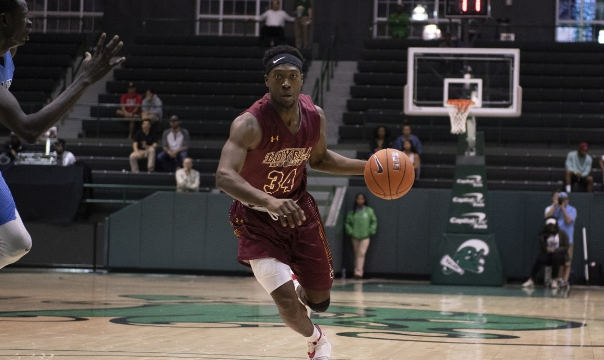 Business sophomore Terry Smith Jr. (34) drives to the basket off of a fast break. Photo credit: Loyola New Orleans Athletics