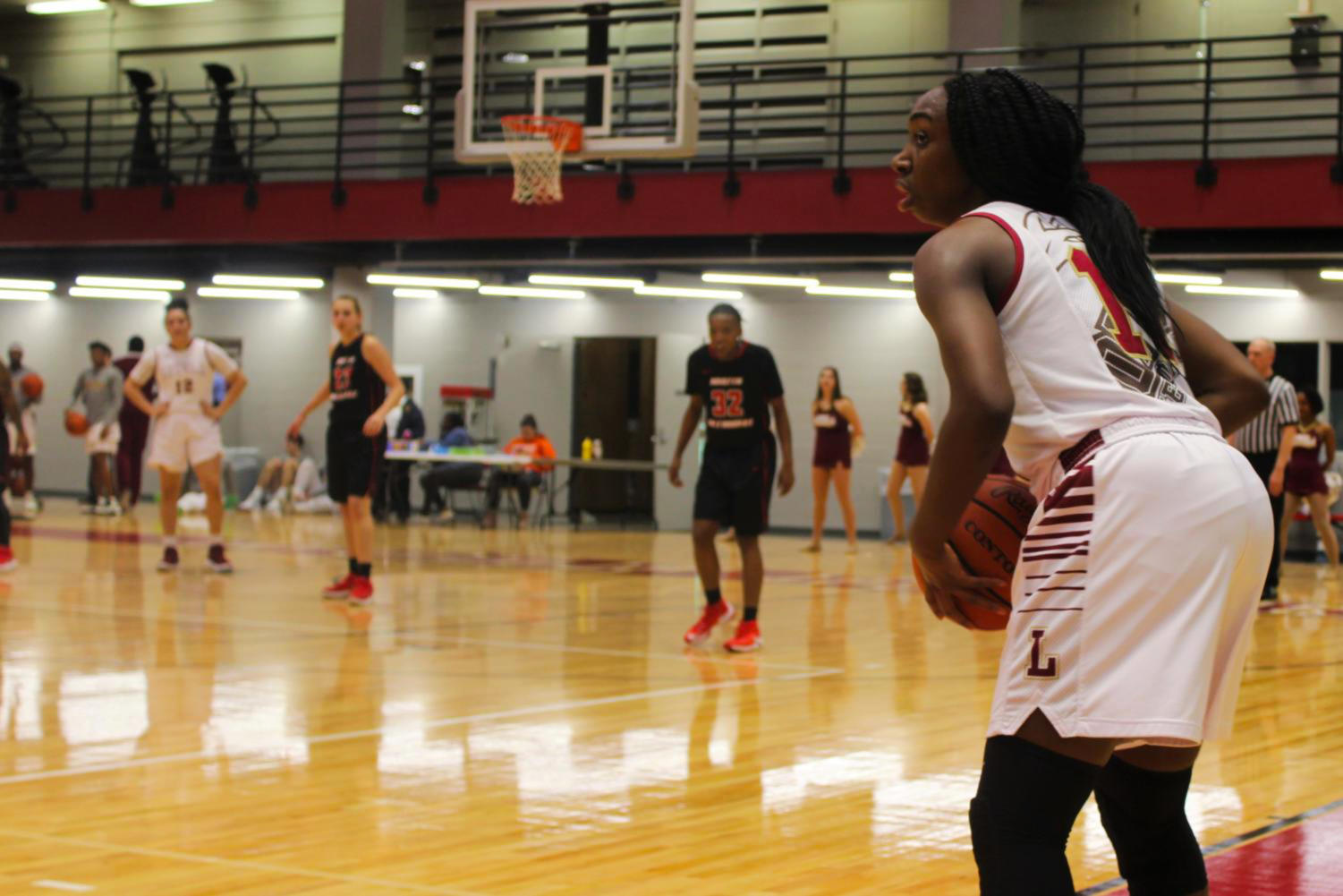 International business sophomore Kaila Anthony (11) looking to send off the inbound pass versus Martin Methodist Feb. 8 2018. Anthony has played this season in a different role. Photo credit: Andres Fuentes