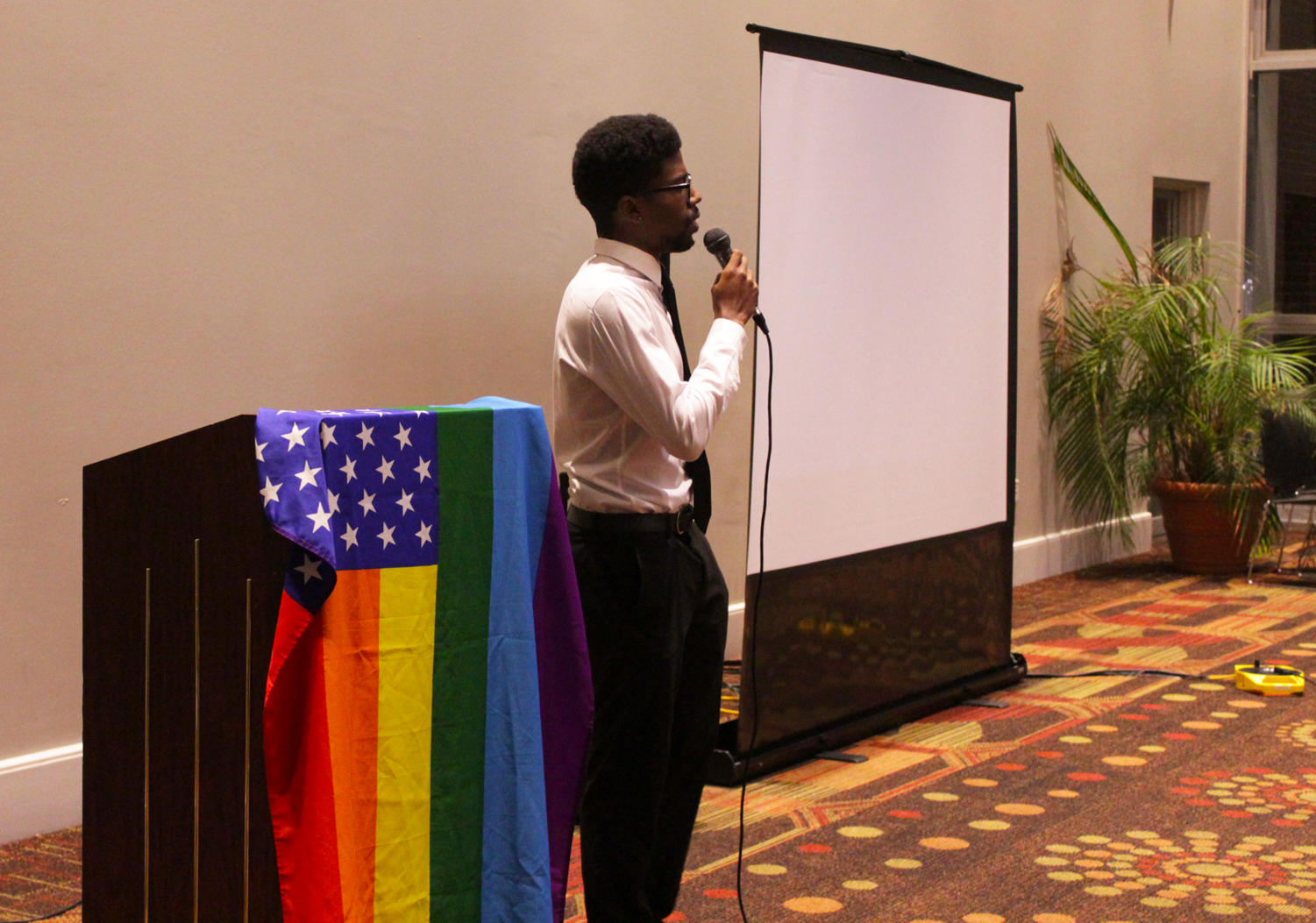 Barry D. McGuire performs a spoken word poem about the difficulties of being a black man in the LGBTQ community at Loyola's World AIDS Day Cocktail Party on Dec. 1.  The event was hosted by Delta Sigma Theta and Loyola's newly formed LGBTQ organization, Plus+. Photo credit: Hannah Renton