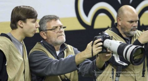 Students learn photography at Saints games
