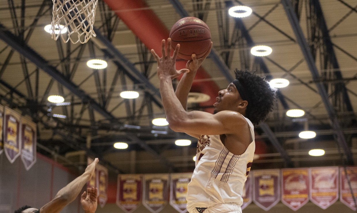 Mass communication freshman Zach Wrightsil nearly recorded a quadruple-double versus the Rams. The starting freshman had a box score of 16 points, 11 rebounds, eight assists, eight steals and four blocks. Photo credit: Loyola New Orleans Athletics