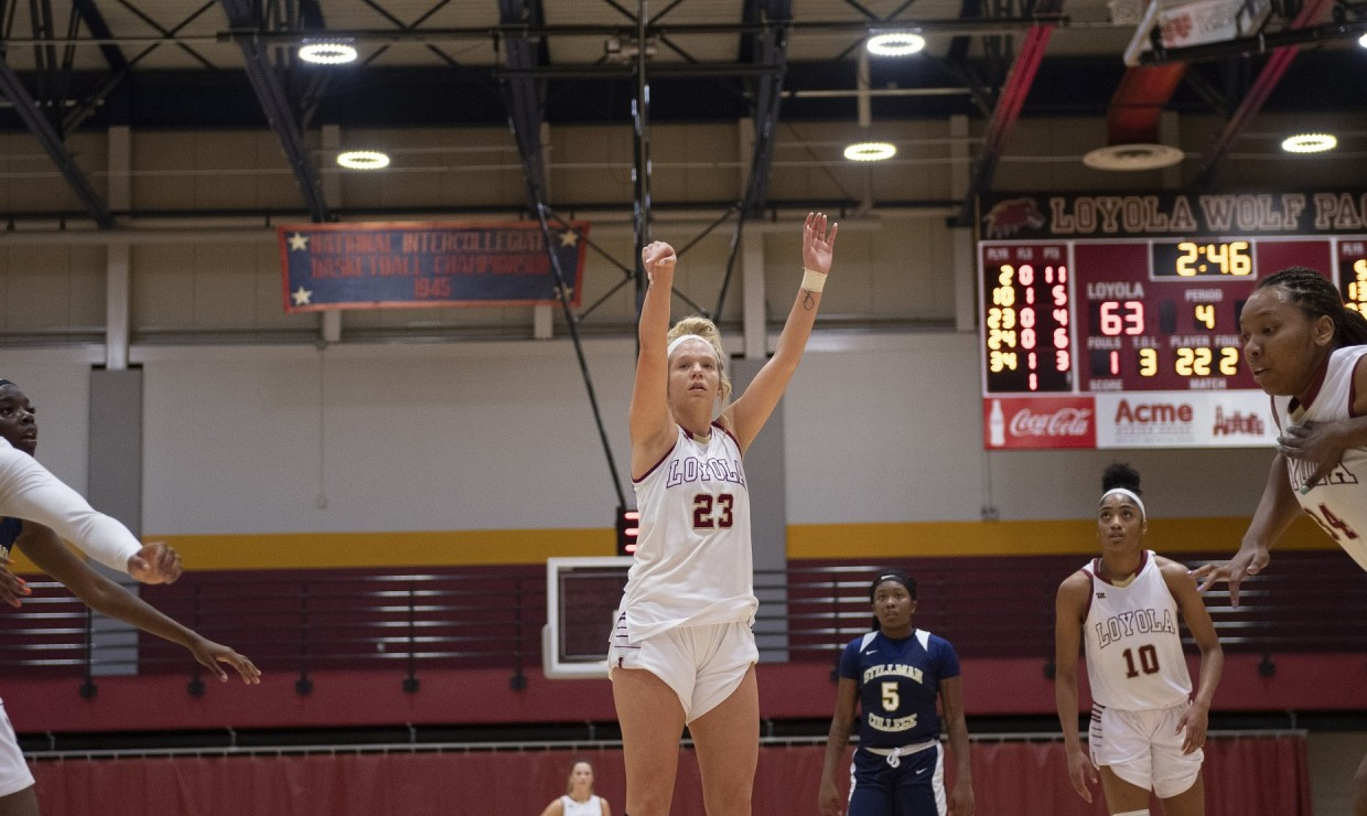 Psychology senior Megan Worry (23) had a career night, leading the team in points, rebounds and assists. She finished with 12 points, 12 rebounds and five assists Photo credit: Loyola New Orleans Athletics