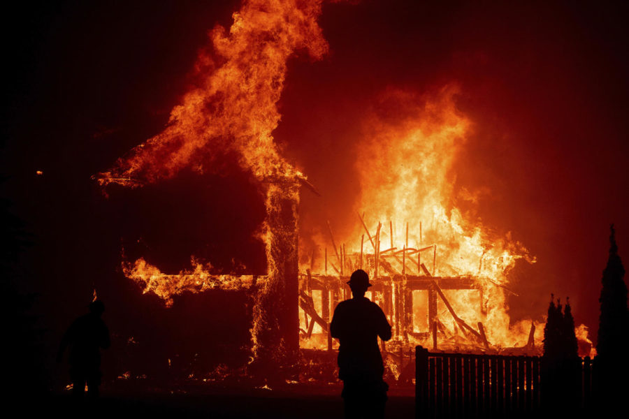 FILE+-+In+this+Nov.+8%2C+2018%2C+file+photo%2C+a+home+burns+as+the+Camp+Fire+rages+through+Paradise%2C+Calif.+California+wildland+managers+announced+a+plan+to+speed+up+logging+and+prescribed+burns+designed+to+protect+communities+from+wildfires%2C+at+a+news+conference+Tuesday%2C+Jan.+29%2C+2019.+The+effort+would+create+a+single+environmental+review+process+to+cover+vegetation+reduction+projects%2C+field+breaks+and+restoration+projects.+%28AP+Photo%2FNoah+Berger%2C+File%29