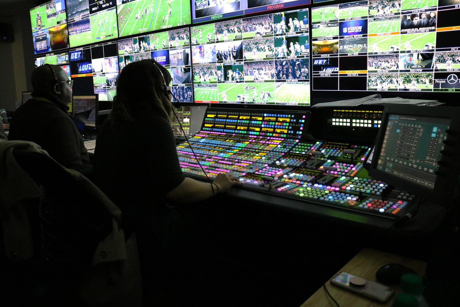 The director of the New Orleans Saints in-stadium production sits in front of her switcher board. Photo credit: Albert Dupont