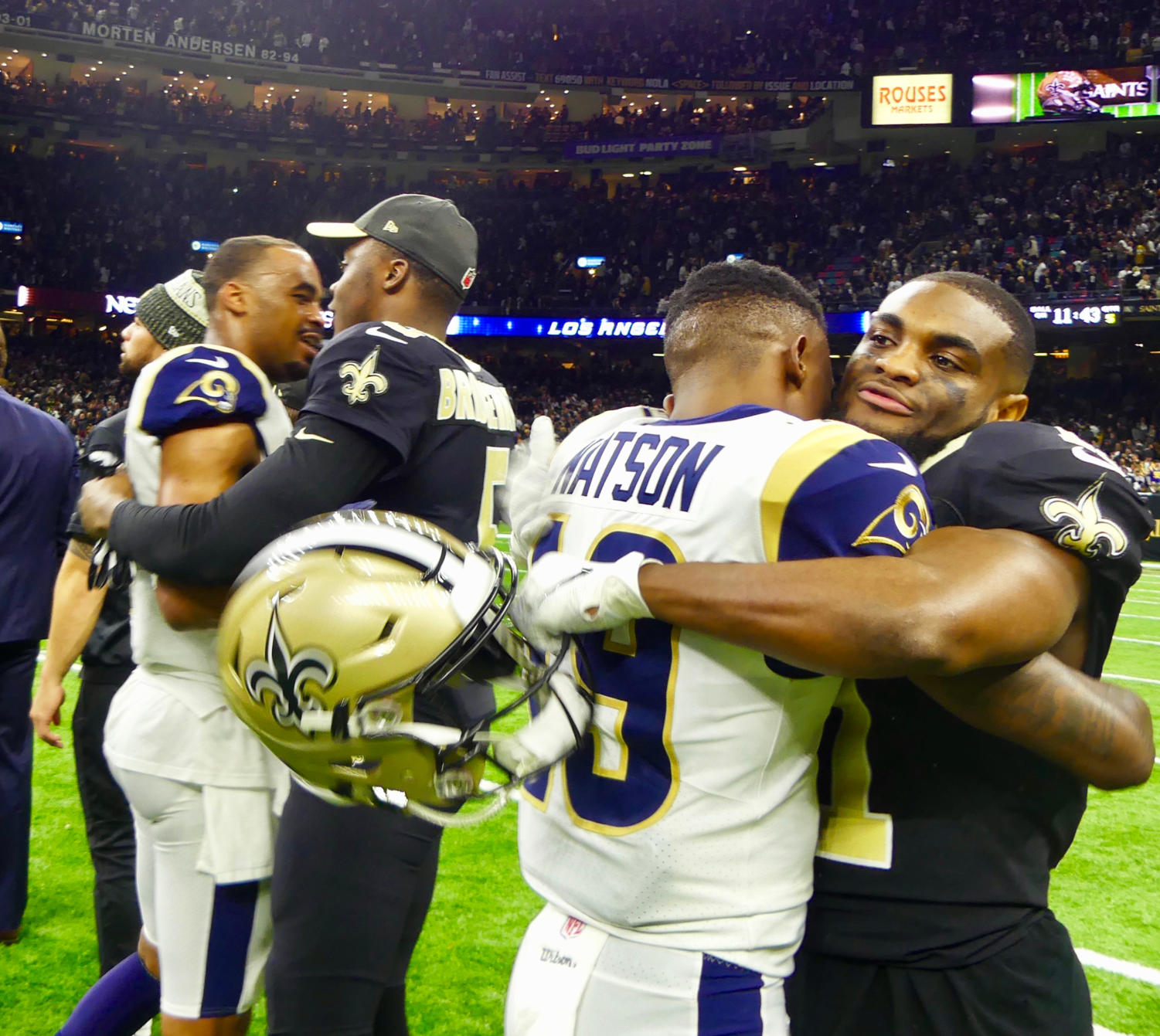 Saints players embrace Rams players after their defeat in the NFC Championship. Photo credit: Olivia Ledet