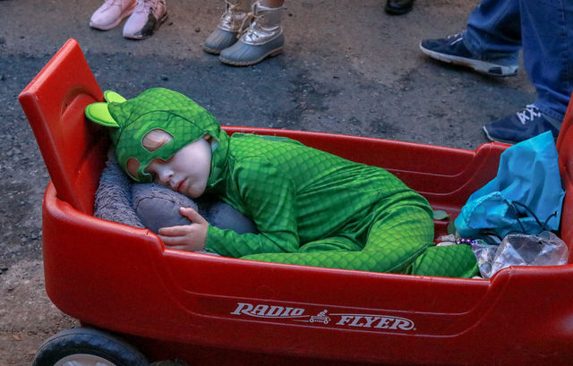 This+little+boy+takes+a+nap+in+the+middle+of+the+parade.