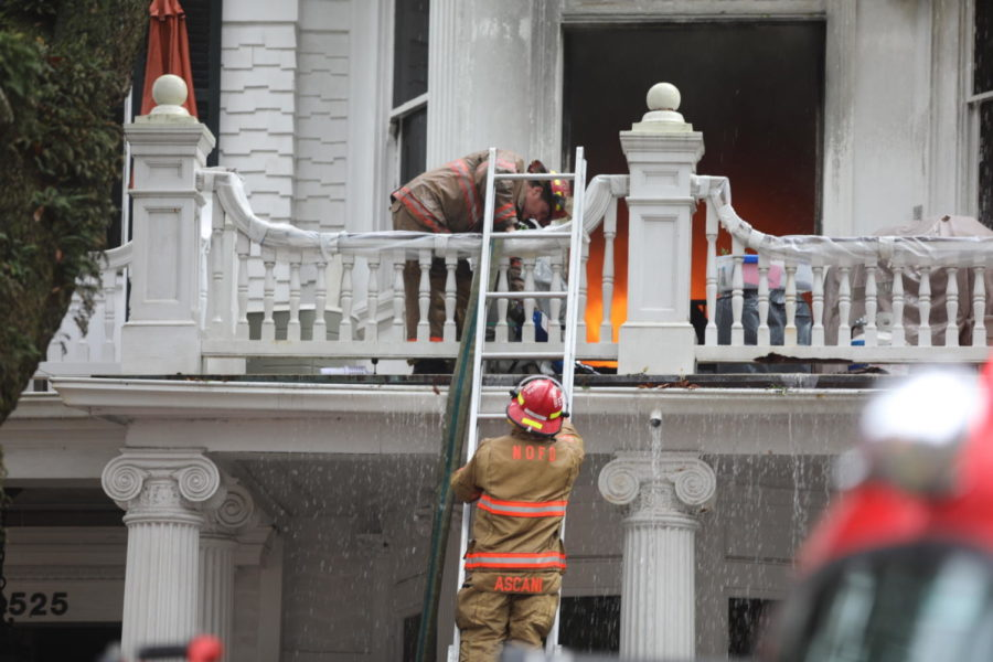 Two+fire+fighters+climb+a+ladder+in+order+to+fight+the+flames+engulfing+the+Rex+Mansion.+The+historic+mansion+caught+fire+early+Wednesday+morning.+Photo+credit%3A+Andres+Fuentes
