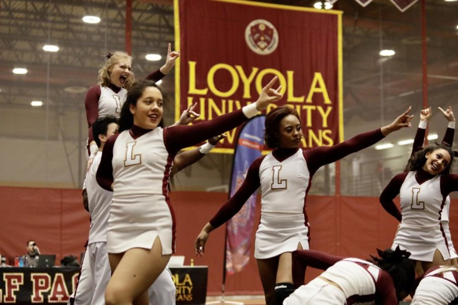 Loyola%27s+cheer+team+performs+their+routine+at+the+Southern+States+Athletics+Conference+Championship+in+The+Den.+The+cheer+team+placed+third+at+the+regional+meet+and+the+dance+team+placed+fourth.+Photo+credit%3A+Ariel+Landry