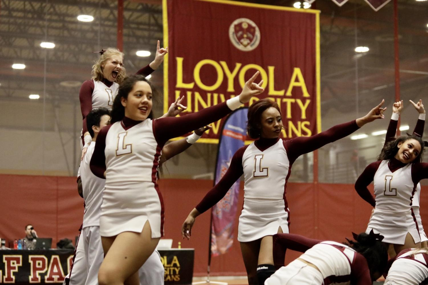Loyola%27s+cheer+team+strikes+a+pose+during+their+routine+in+the+conference+championships.+Photo+credit%3A+Ariel+Landry