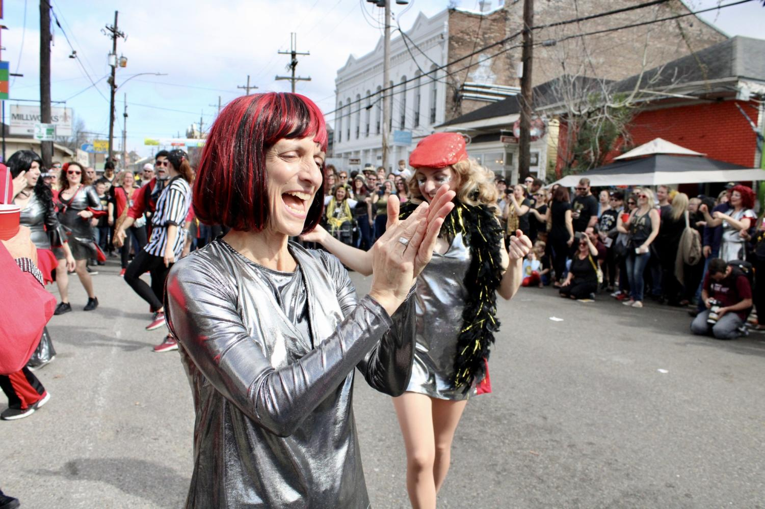 A+member+of+a+dance+krewe+dances+in+the+center+of+the+Magazine+Street+block+party.+Photo+credit%3A+Madison+Mcloughlin