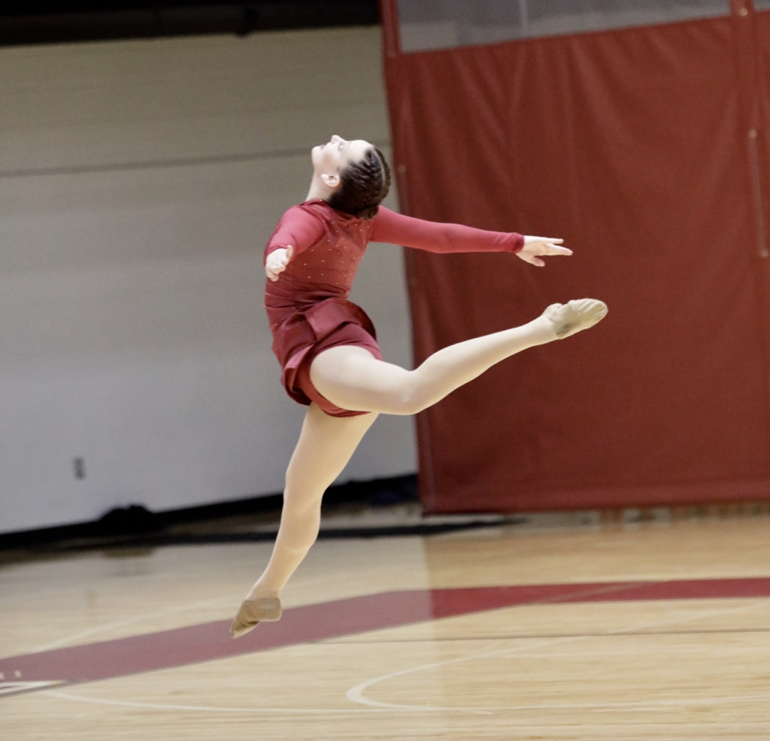 Music+industry+studies+junior+Beth+Cohen+leaps+during+the+individual+dance+competition.+Photo+credit%3A+Ariel+Landry