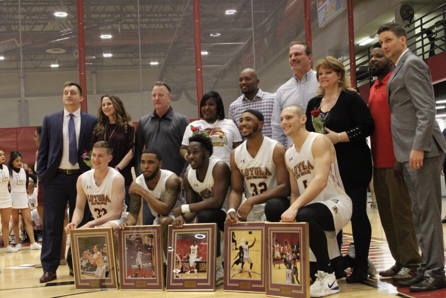 All+five+men%27s+basketball+senior+pose+for+a+photo+with+their+families+at+Senior+Night.+Photo+credit%3A+Rosha%27E+Gibson