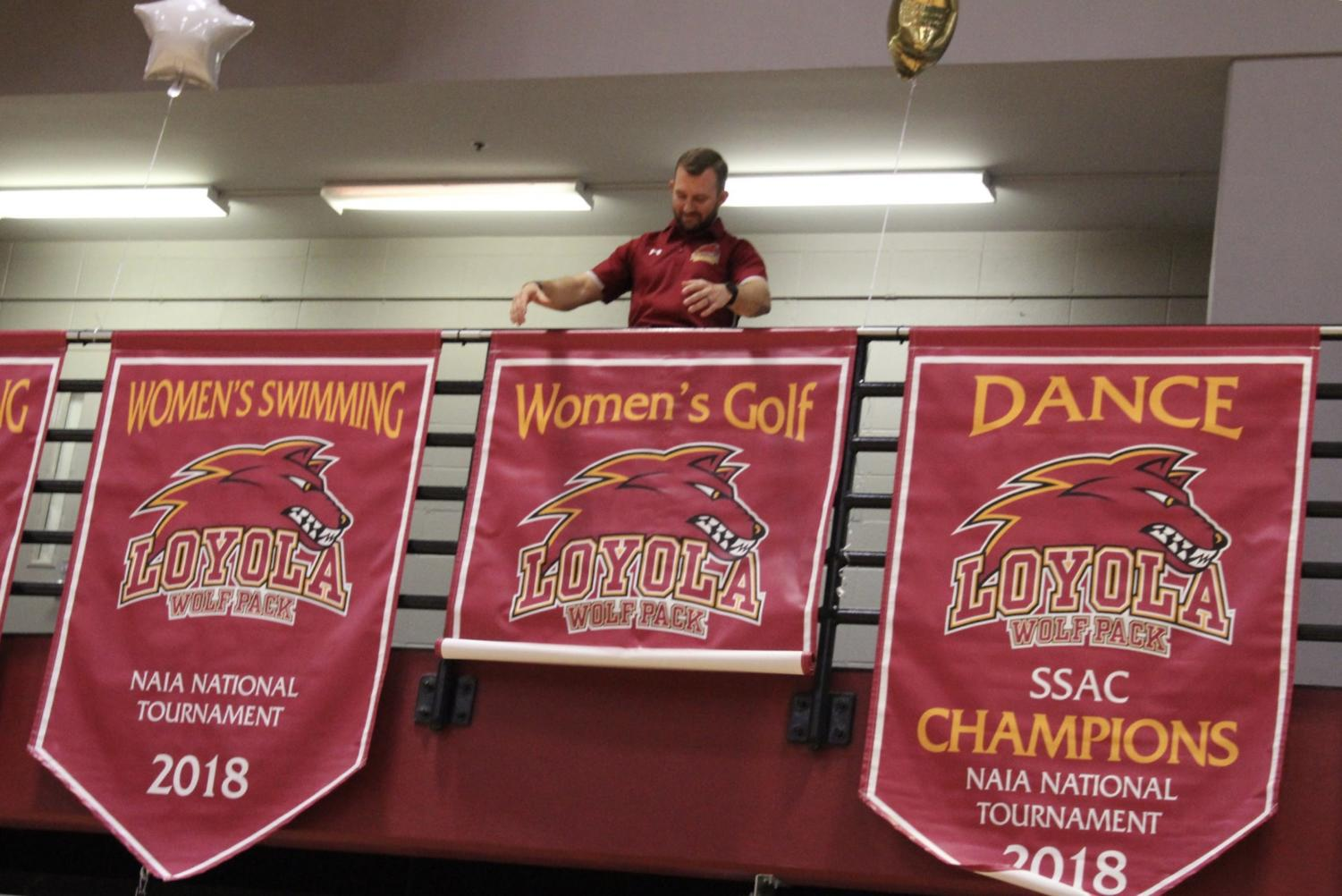 Four+championship+banners+were+revealed+at+Senior+night.+The+dance+team%2C+women%27s+golf+team+and+both+swim+teams+received+a+new+banner.