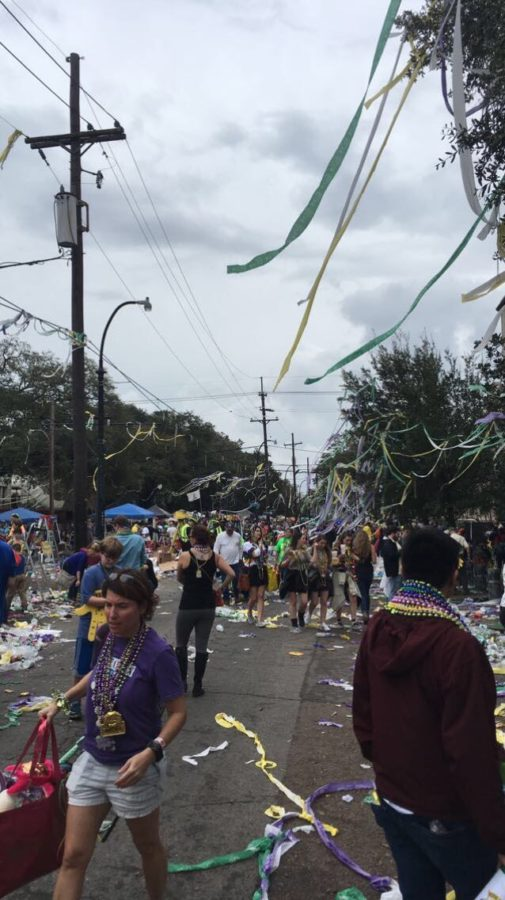 Beads%2C+streamers+and+trash+litter+the+streets+and+hang+from+trees+after+a+parade+during+last+year%E2%80%99s+Mardi+Gras.+Nearly+1%2C200+tons+of+trash+were+collected+during+the+2018+Mardi+Gras+parade+season%2C+with+artifacts+like+beads+hanging+from+trees+remaining+in+the+city+for+years+to+come.+ANDERSON+LEAL%2FThe+Maroon.+Photo+credit%3A+Anderson+Leal