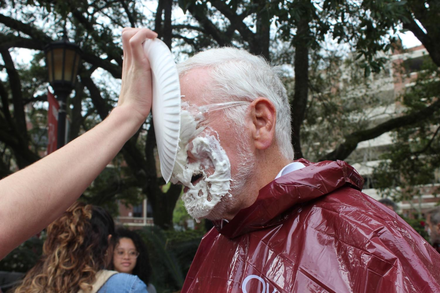 Bob+Thomas%2C+director+of+the+Center+for+Enviornmental+Communication+recieves+a+plate+of+shaving+cream+to+the+face+on+Feb.+26.+The+pieing+was+part+of+a+University+Honors+Association+event+that+asked+students+to+donate+%241+to+the+Gulf+Restoration+Network+in+exchange+for+pieing+a+participating+professor.+